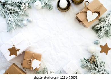 Christmas background with xmas gifts on white creased paper. Merry Сhristmas greeting card. Winter season holiday background. Happy New Year.