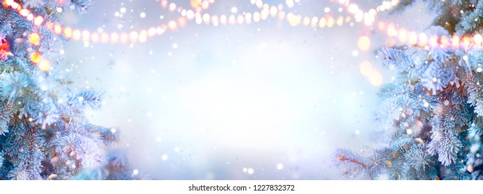 Christmas background. Xmas tree with snow decorated with garland lights, holiday festive background. Widescreen frame backdrop. New year Winter art design, Christmas scene