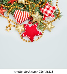 Christmas Background with Xmas Tree Twig, Glitter Golden Stars, Garland and Xmas Decor