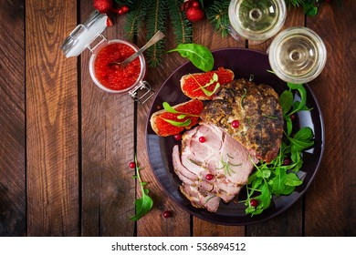 Christmas baked ham and red caviar, served on the old wooden table. Top view. Flat lay