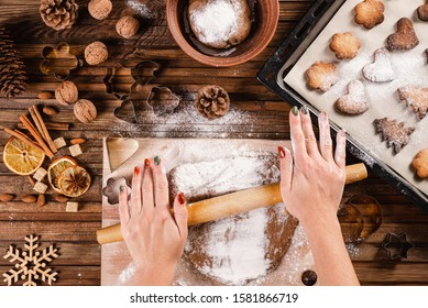 Christmas bakery. Cooking homemade cookies. Wooden background. Top view.