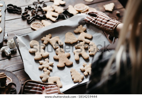 Christmas bakery. Festive food, cooking process, family culinary, Christmas and New Year traditions concept. Woman hands holding homemade gingerbread cookies