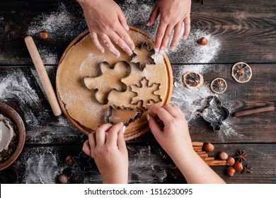 Christmas bakery. Friends making gingerbread, cutting cookies of gingerbread dough, view from above. Festive food, cooking process, family culinary, Christmas and New Year traditions concept