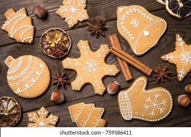 Christmas baking  background. Christmas gingerbread cookies with spices at dark wooden table. Top view.