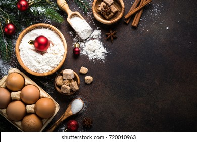 Christmas Baking background. Ingredients for cooking christmas baking on dark rusty background. Top view with copy space.