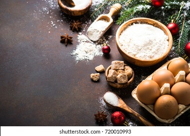 Christmas Baking background. Ingredients for cooking christmas baking on dark rusty background.