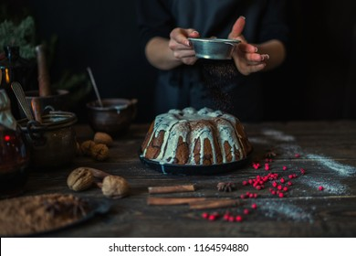 Christmas baking. Cooking homemade cake at home rustic kitchen. Woman's hands. Ingredients for cooking christmas baking on dark wooden table. Holidays, winter, Christmas concept. Soft focus.