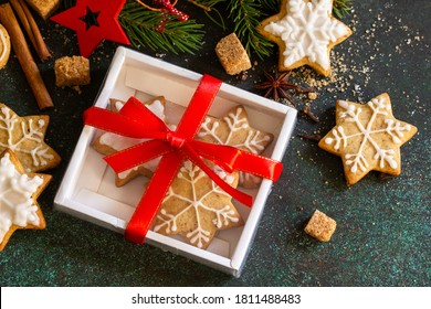 Christmas baking. Homemade Gingerbread cookies in a gift box on a stone or slate background.