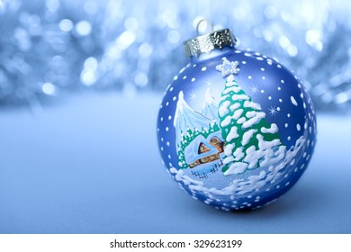 Christmas ball blue and white on blurred background new year
