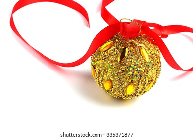 Christmas ball decorated with festive ribbon