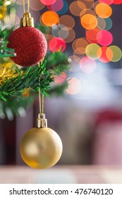 Christmas ball decoration against bokeh light background
