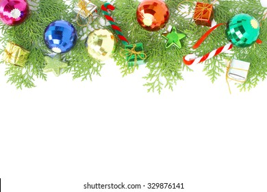 Christmas ball decoration and pine leaves on white background