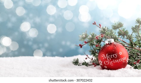 Christmas ball and fir branch on abstract background