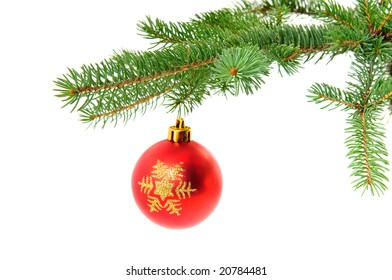 Christmas ball handed on pine branch isolated over white background