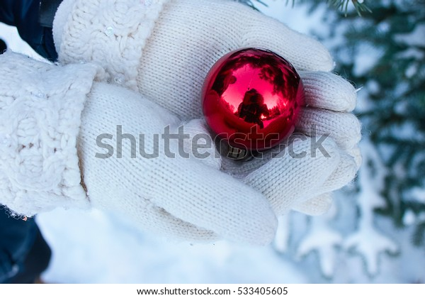 Christmas ball in hands