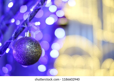 The christmas ball hanging on the tree with bokeh background