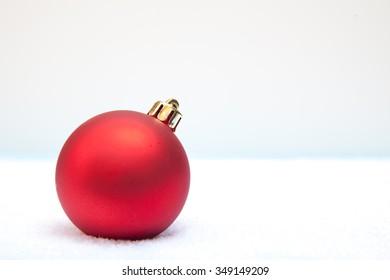 Christmas ball lying on snow