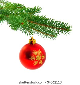 Christmas ball on fir tree branch isolated over white background
