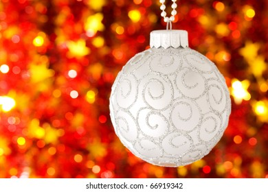 Christmas ball on red blurred background