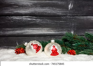 Christmas ball on a wooden board