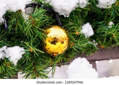 Christmas ball over a tree with snow, horizontal image