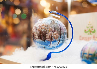 Christmas ball painted by winer trees. Christmas decoration