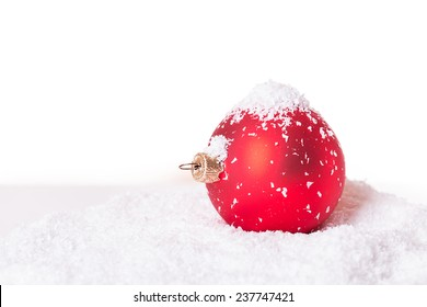 Christmas ball in the snow Isolated on white background