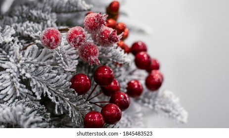 Christmas ball snow-covered fir tree, close-up, blurred bokeh background. Christmas background for a postcard. Decoration for a Christmas tree, spruce branches, New Year's toys.