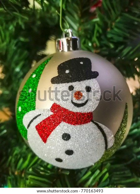 Christmas ball with Snowman decoration hanging on the tree