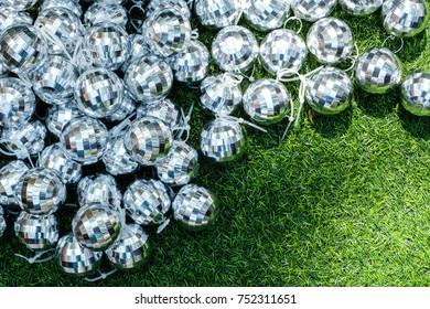 Christmas ball texture  / Christmas decoration on Green Grass