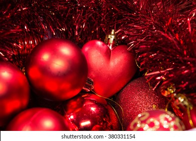 Christmas balls decorations in  gift box . Red , heart. Background