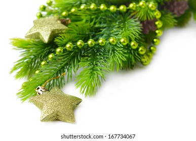 Christmas balls and decorative stars on fir tree, isolated on white