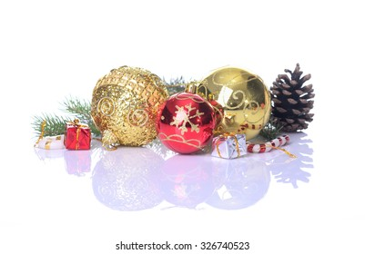 Christmas balls and fir branches with decorations isolated