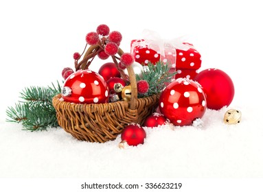 Christmas balls and fir branches with decorations isolated over white