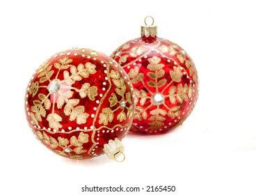 christmas balls focus on hook of closer ball with shallow depth of field on white