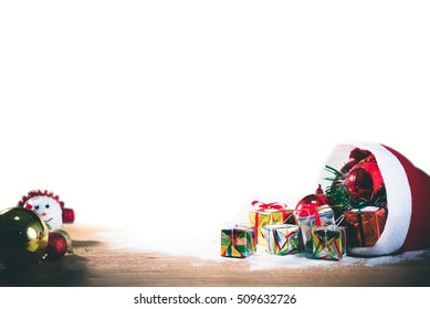 Christmas balls and gift box decorations in Santa clause bag on wooden backgrounds, merry Christmas in December 2017