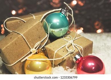 Christmas balls and gifts on snow