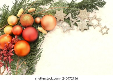 Christmas balls and glitter stars on white background and snow
