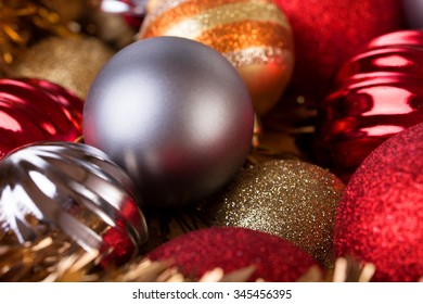 christmas balls in gold, red and silver stacked as background for xmas party / Christmas balls decorative for christmas holiday background