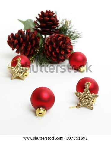 d469ccfae463 Christmas Balls with gold stars and red pine cones in the background. Focus  is on