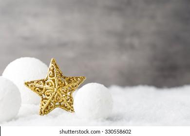 Christmas balls, greeting card and fir tree on snow.