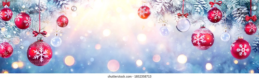 Christmas Balls Hanging Fir Branches With Lights In Abstract Defocused Background