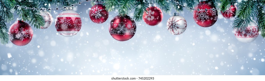Christmas balls hanging on fir branch