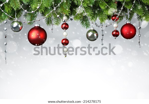 Christmas balls hanging on snowy fir tree