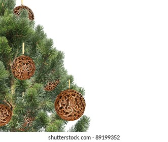 Christmas balls hanging with ribbons on fir tree over white