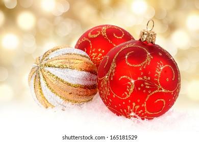 Christmas balls isolated on golden background