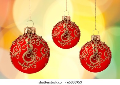 Christmas balls on abstract violet lights as background