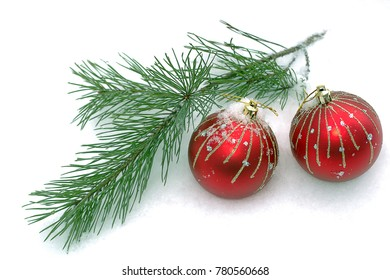 Christmas balls on a branch in winter forest