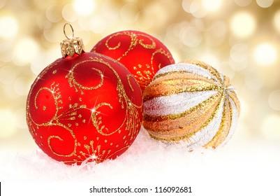 Christmas balls on golden background