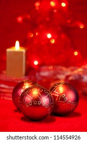 Christmas balls on red with candle